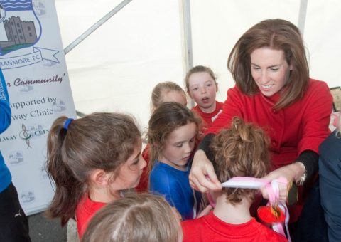 Hildegarde awarding medals at Deputy Hildegarde Naughton presenting an award to the Girls U8 FC Team, at the Maree Oranmore Soccer Tournament.