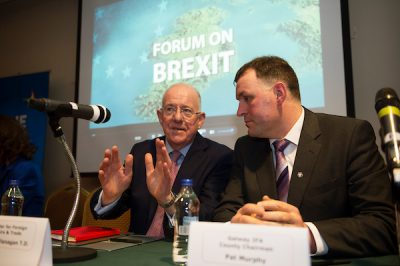Charlie Flanagan speaking to Pat Murphy at brexit meeting in galway